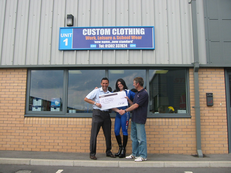 Andy Needham Custom Clothing Presenting Cheque to Tori-and Paul Vasey