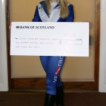 Charlotte with Cheque for GNAA