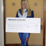 Charlotte with Cheque for Great North Air Ambulance