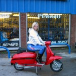 Faye on red scooter outside AF Rayspeed