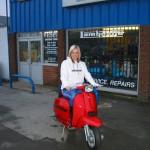 Faye sitting astride red scooter at AF Rayspeed