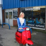 Faye sitting on red scooter at AF Rayspeed
