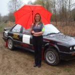 Sara and her red umbrella with black BMW